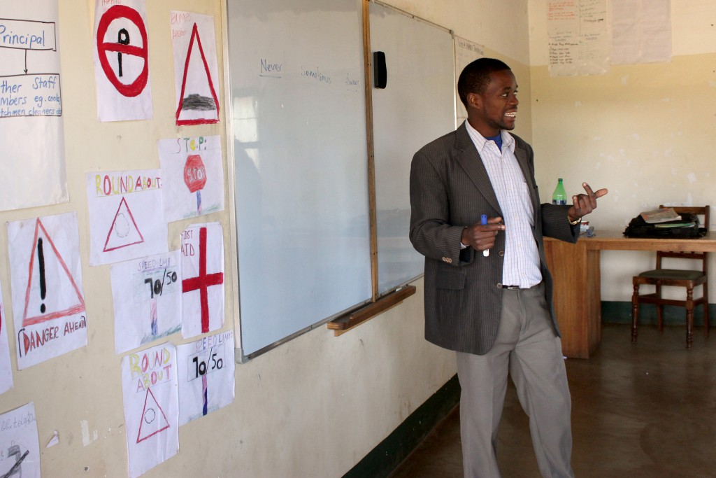 One of the few classrooms with whiteboards, Frank teaches his class English